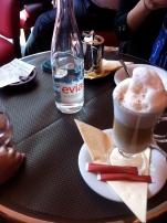 In Paris, enjoying a cappuccino