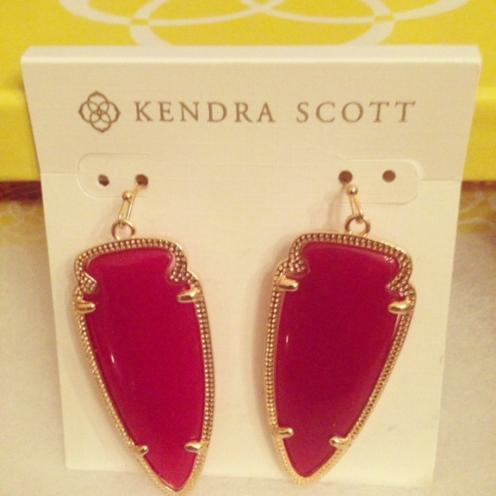 Kendra Scott red earrings.